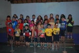 students of Cl. 2E sang 'Day O and the Coconut Woman'