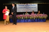 Mrs. Edna Rodrigues  receiving award for 25 years of service