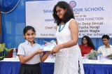 Gold Medalist (Trusha N.) giving away the awards
