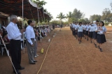 The Std XA Batch  marching past the Chief guests and audience